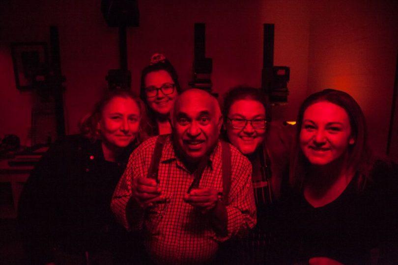 Merv Bishop and four women in photo darkroom