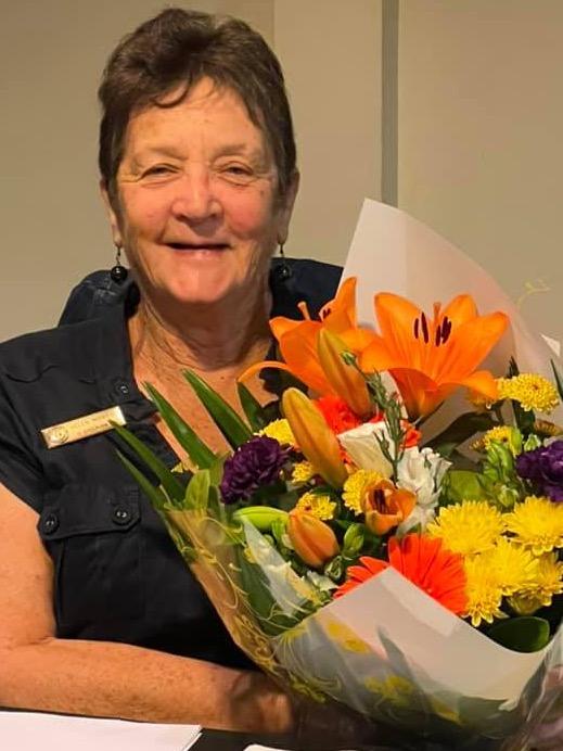 Helen Morgan holding flowers
