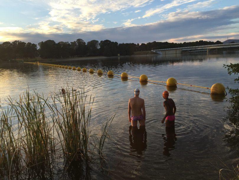Ben Freeman and Eskindir Gavel swim training in Lake Burley Griffin