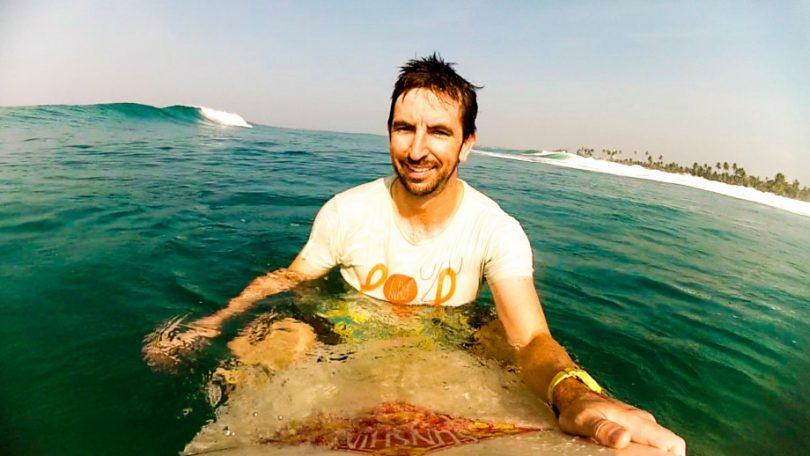 Dr Nicholas Taylor surfing
