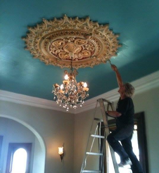 Steve Hazelton painting ceiling rose in mansion at 'Teneriffe'