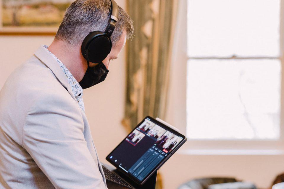 Wedding photographer Michael Conlin checking a livestream camera