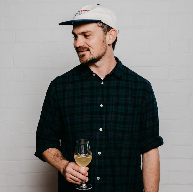 Max Walker with a glass of wine