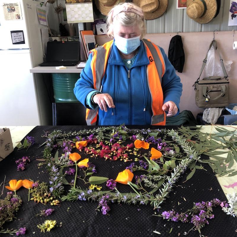 Jennifer arranging flowers at Growing Abilities