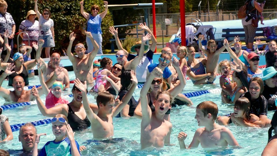 People cheering in a pool in Batemans Bay.