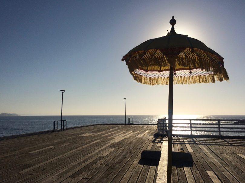 Empty wharf facing sea on NSW South Coast.
