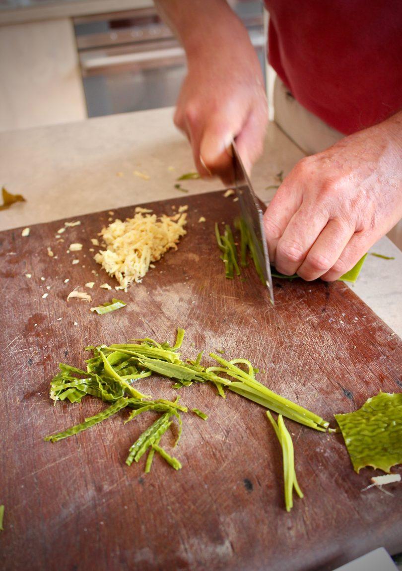 Prepairing golden kelp seaweed salad