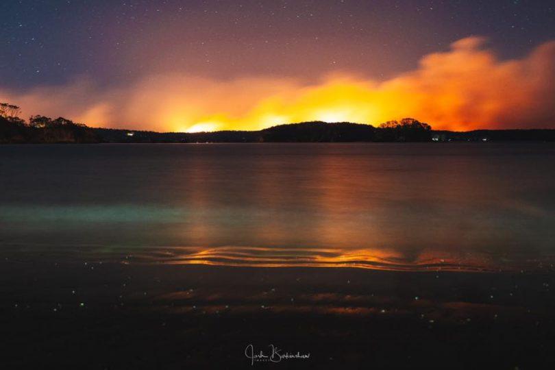 Bushfire at Currowan, as seen across water from Batemans Bay.