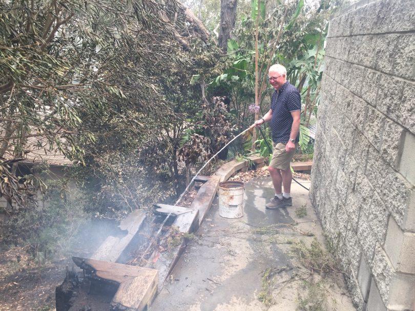 The verandah under his neighbour's house is still burning.
