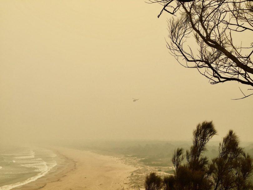 Chopper moving through the smoke