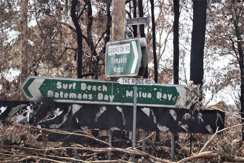 Fire-damaged sign in Batemans Bay