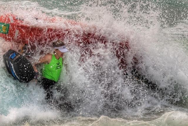 Wave crashing over surfboat