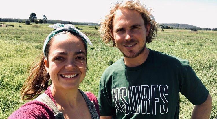 Eliza and Alex posing on their farm.