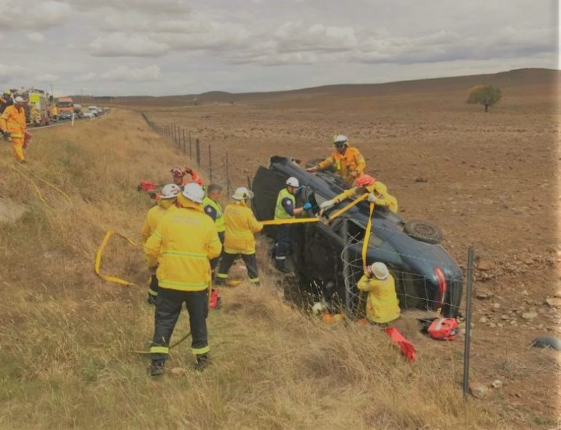 Rural Fire Service crew attend to single car accident south of Cooma.