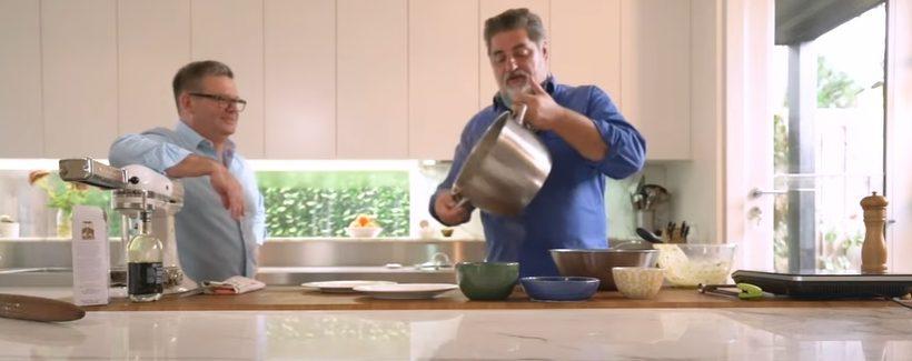 Celebrity chefs Gary Mehigan (left) and Matt Preston (right) cooking in kitchen.