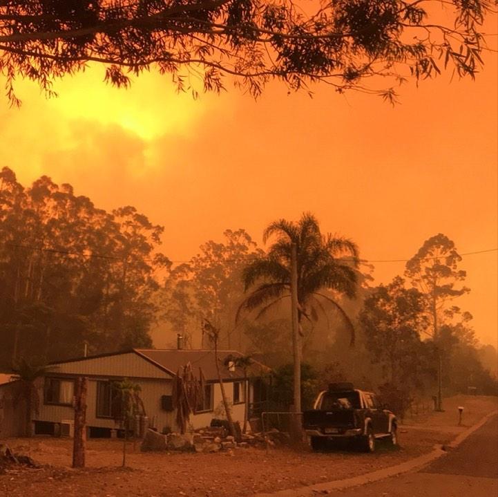 House in Mogo through thick smoke.