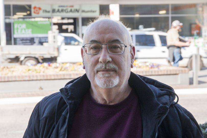 Bill Furneaux standing on street.