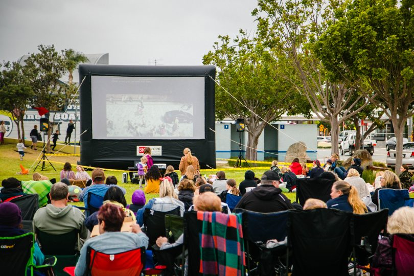 Crowd watching film at outdoor cinema on Batemans Bay waterfront.