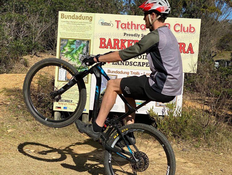 Michael Parker riding his bike in bushland in Tathra.