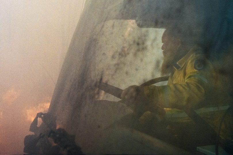 Volunteer RFS firefighter driving truck.