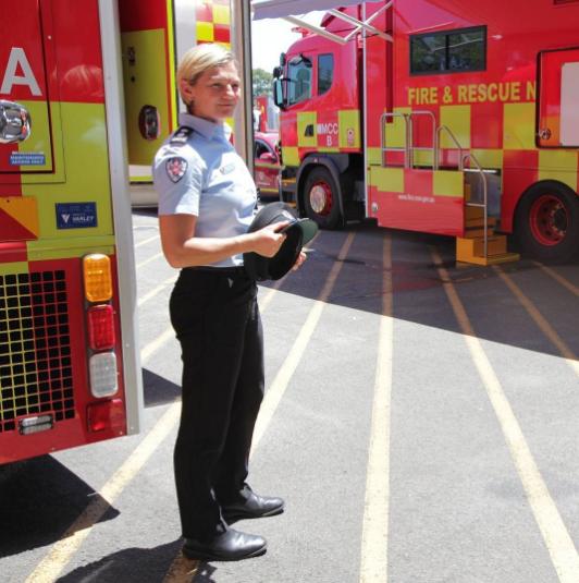 Bronnie Mackintosh standing next to fire truck.
