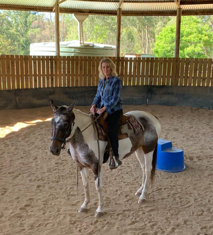 Kim Treasure sitting on Molly the horse.