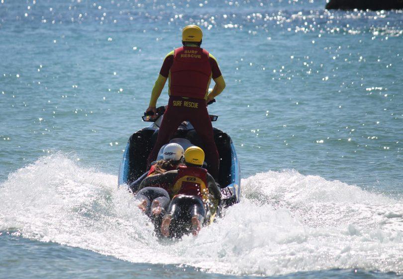 Surf lifesavers training on jet ski.
