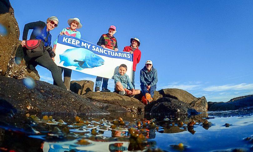 Members of Save Batemans Sanctuaries holding sign.