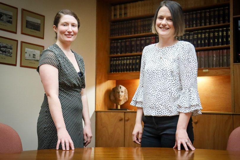 Georgina Love and Carmen Swaffield inside office of Davis Faulkner Lawyers.