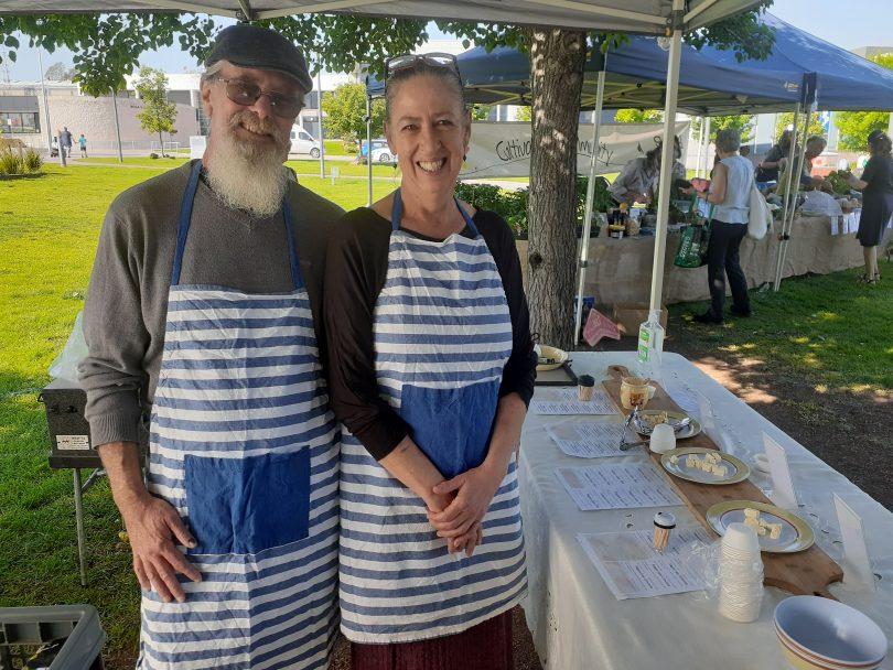 Wayne White and Lisa Kremmer at cheese stall at Bega Farmers Market.