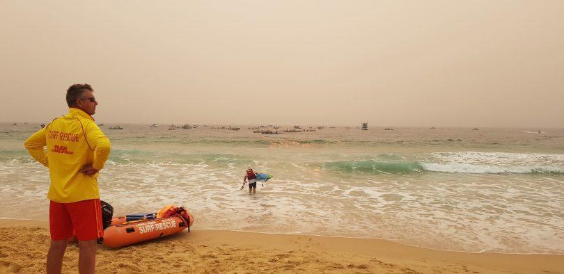 Lifeguard watching George Bass Surfboat Marathon at Moruya Beach