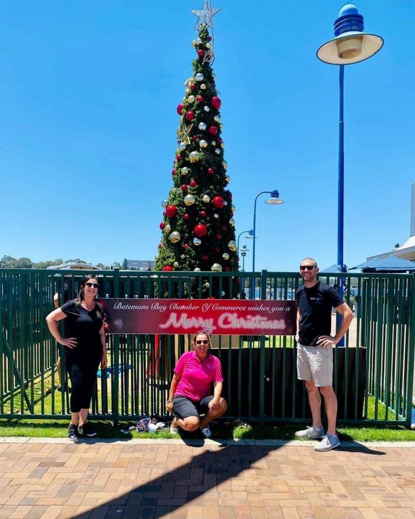 Rebecca Mahon, Marieke Janssen and Mathew Hatcher in front of Christmas tree.