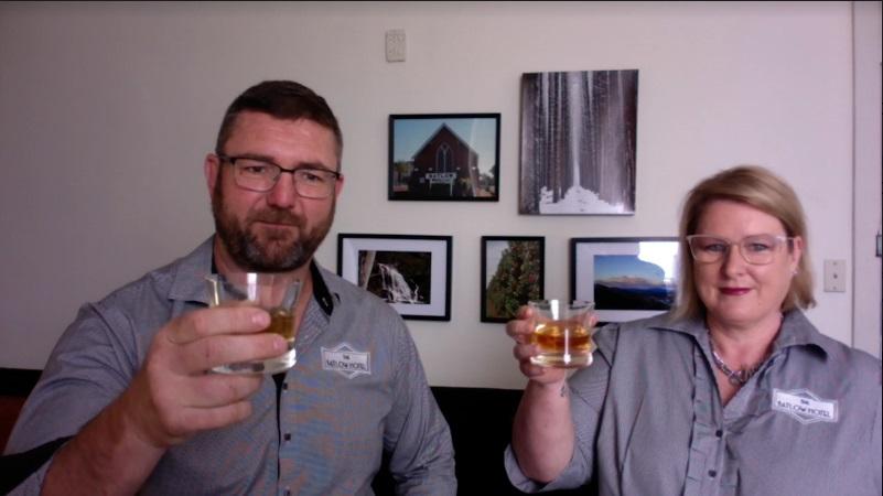 Matt and Linda Rudd holding glasses of bourbon.