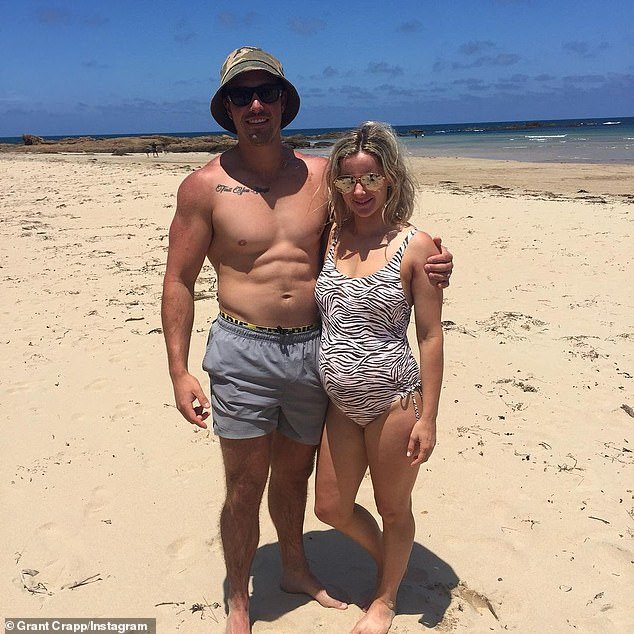 Grant Crapp and pregnant Lucy Cartwright on beach.