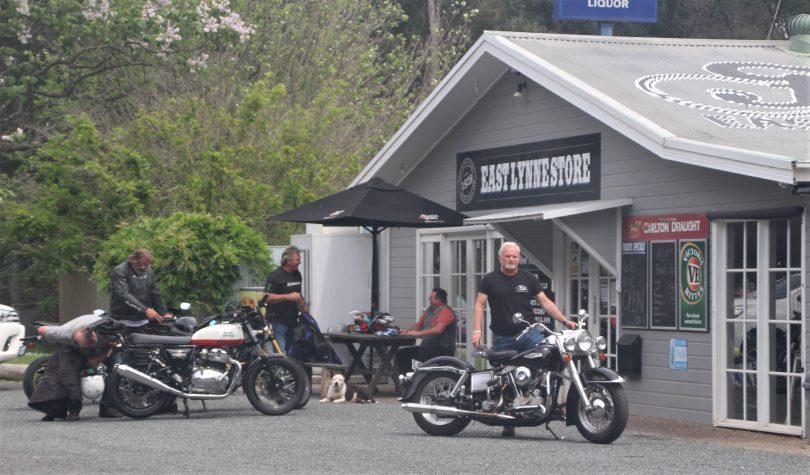 Bede Cooper with motorbike outside Fuel East Lynne.