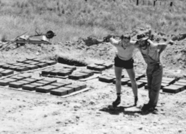 Richard Glover and Philip Clark making mud bricks.