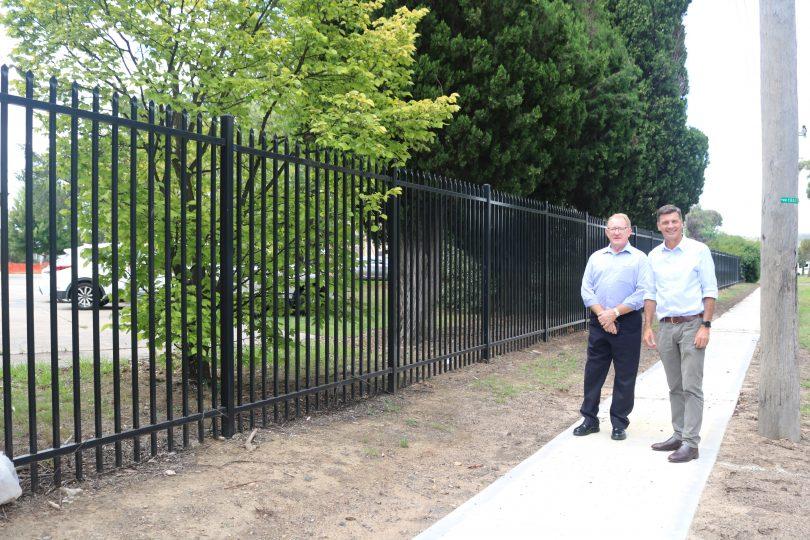 Bob Kirk and Angus Taylor standing on footpath.