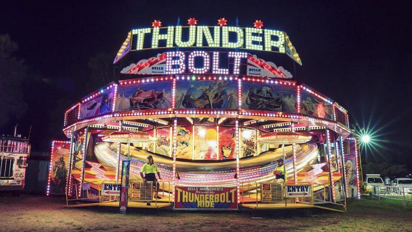 Thunderbolt carnival ride at night.