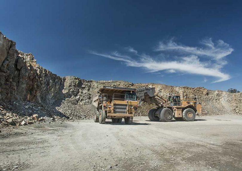 Heavy vehicles at Gunlake Quarry.