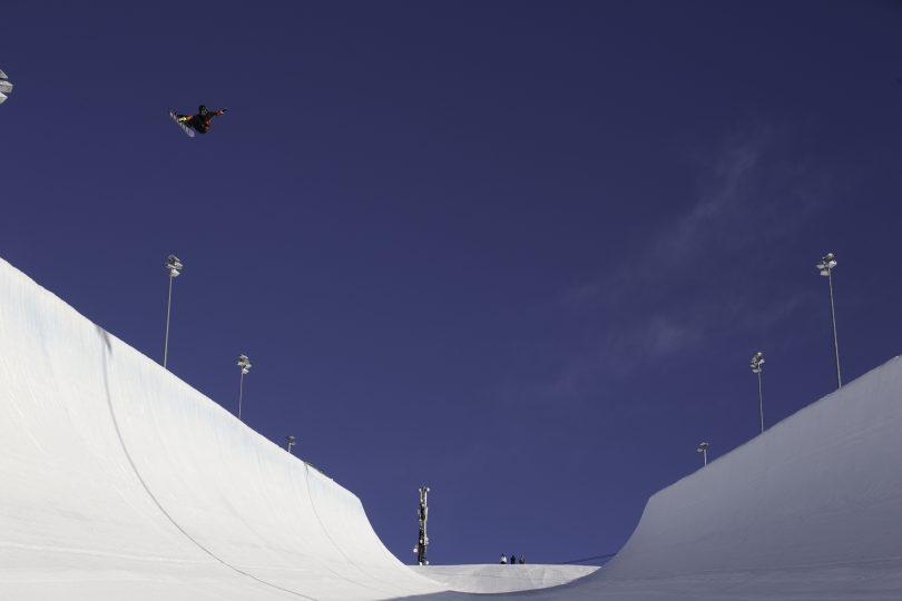Valentino Guseli airborne on snowboard halfpipe