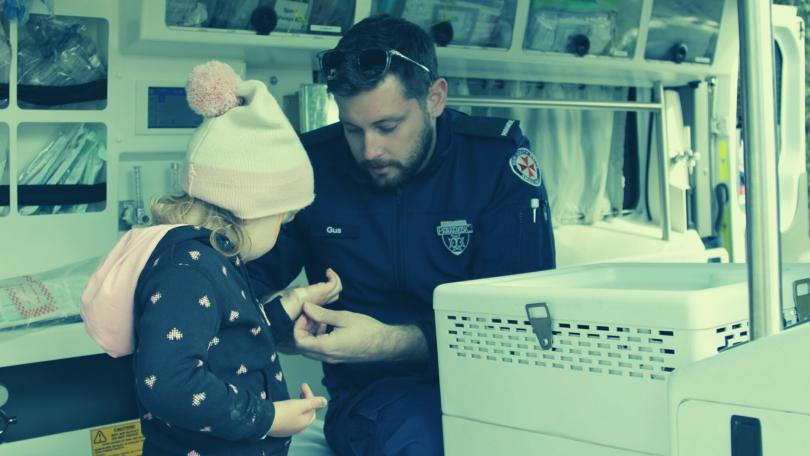 Paramedic treating child