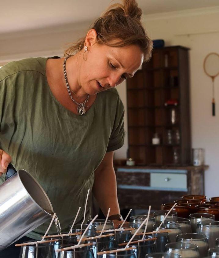 Sarah Ryan pouring candle wax