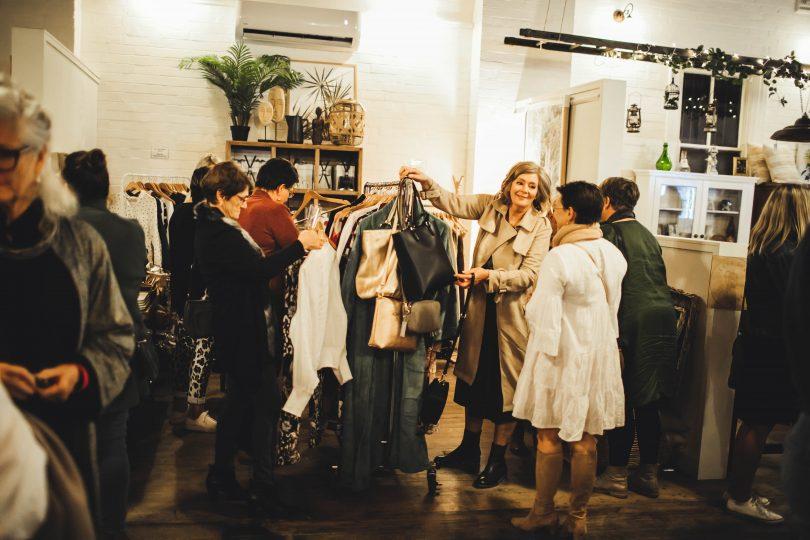 Shoppers inside Ensemble & Co