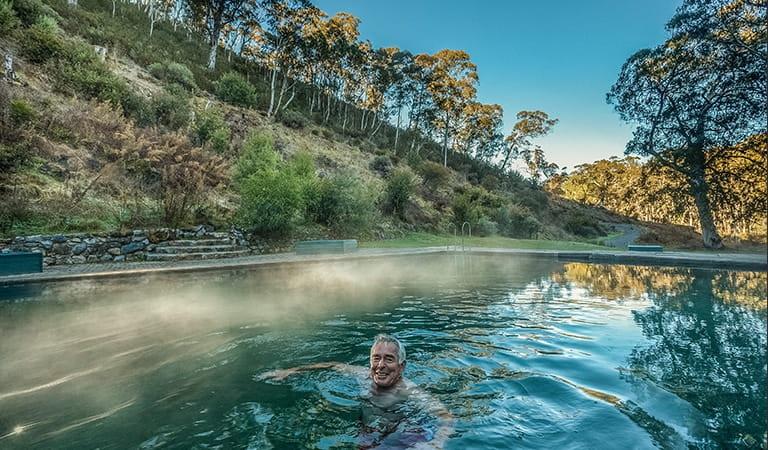 Man swimming in thermal pool