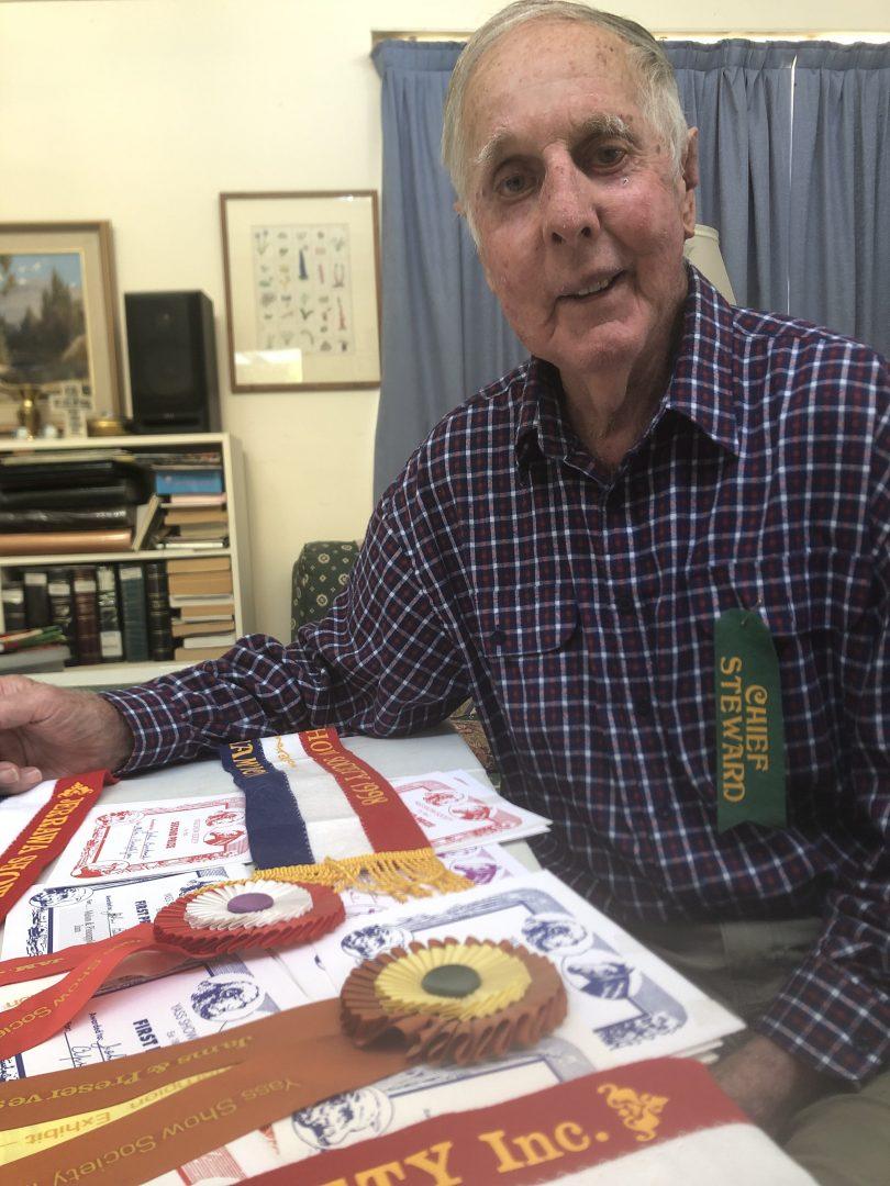 John Buckmaster with show ribbons
